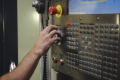 Staff Sgt. Jared Henden, 2nd Maintenance Squadron Fabrication Flight aircraft metals technology journeyman, adjusts the settings of the Computer Numerical Controlled machine at Barksdale Air Force Base, La., Sept. 13, 2016. It would take hours to create a component manually, but using the CNC will take a considerably less amount of time while being precise to 0.001 of an inch. (U.S. Air Force photo/Airman 1st Class Stuart Bright)